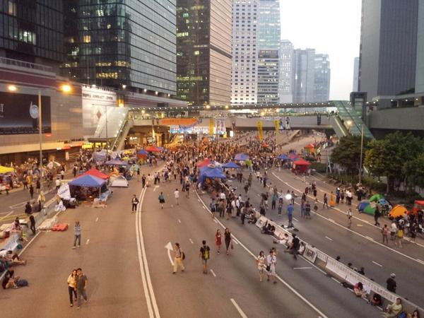 Twilight time, a steady stream of protestors headed to Admiralty. Reporters scattered around.