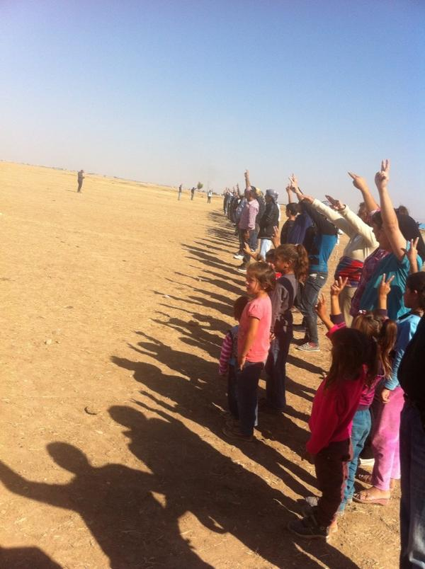 Refugees from Kobane being stopped at the Turkish border. Waiting for a massacre.