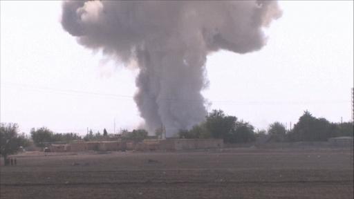 Plumes of smoke rise from Kobani following air