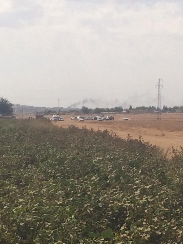 Gunfire in the distance from about 3km away. Some smoke rising from various points across Kobane.