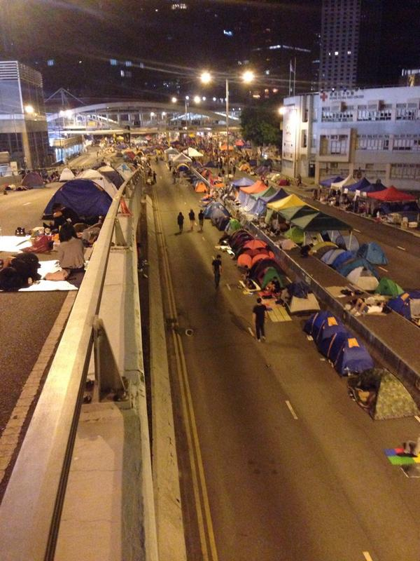 There aren't many more people staying over than in previous nights, but the tents emphasize their determination.