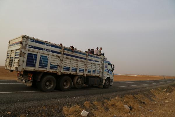 Civilians still leaving Kobane.  2 trucks with refugees entering Turkey