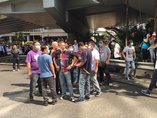 Gang members planning their attacks on barricades