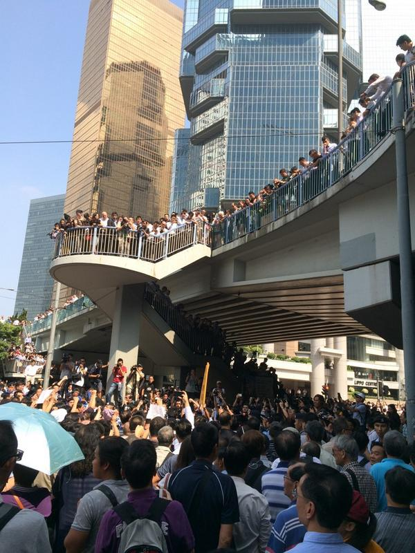 Police losing control, more fights, middle of the day, office workers on lunch on bridge watching over it all