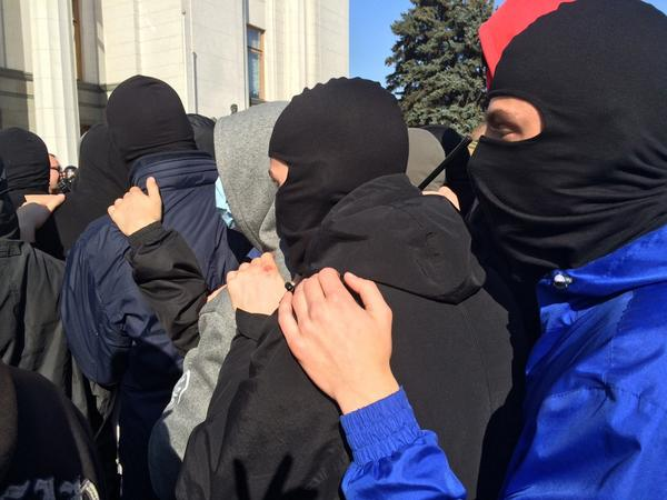 People in masks, asks the national guard near Rada : Well, boys, ready to die?
