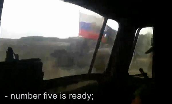 Russian com. gives soldiers the order to bombard a Ukrainian village with rocket launchers.