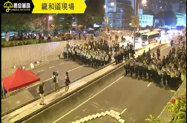 Police line gradually moving forward.