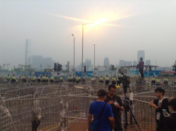 Still many police officers in the road outside LegCo, on Lung Wo Road to ensure it stays open.