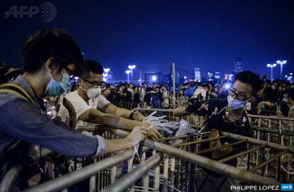 Pro-democracy protesters set up a barricade following a standoff with police