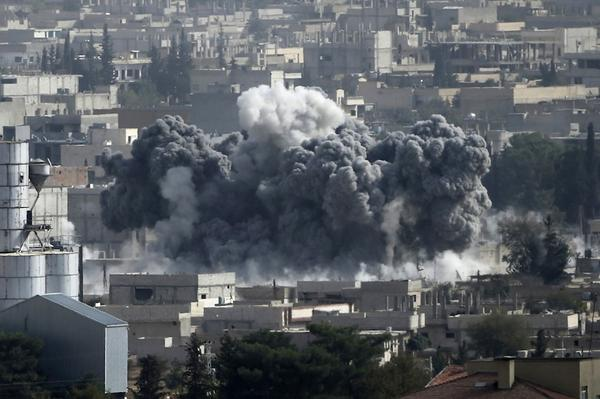 An suicide bomber detonates a truck laden with explosives in Kobane on Monday