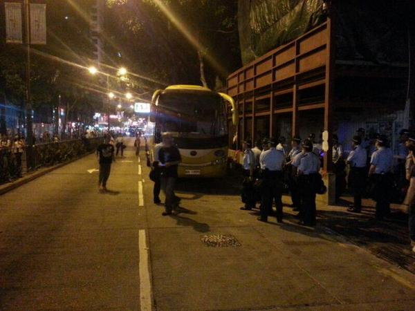 Scene near Police HQ in  Wanchai: police officers waiting off Lockhart Rd.