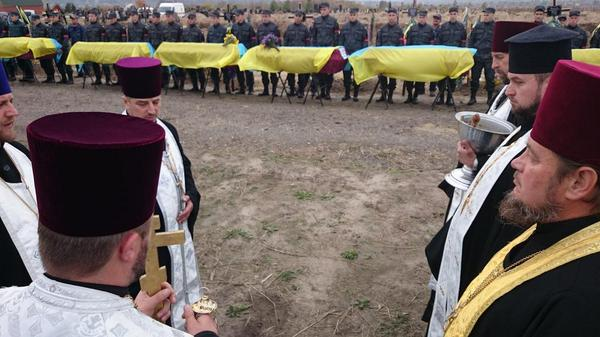 21 Unknown Ukrainian army soldiers are being buried on a dedicated cemetery near Dnepropetrovsk,  Ukraine