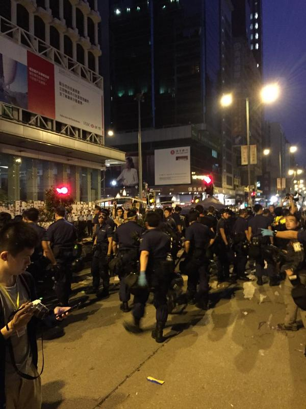 500-600 police dismantling occupy site in Mong Kong now.