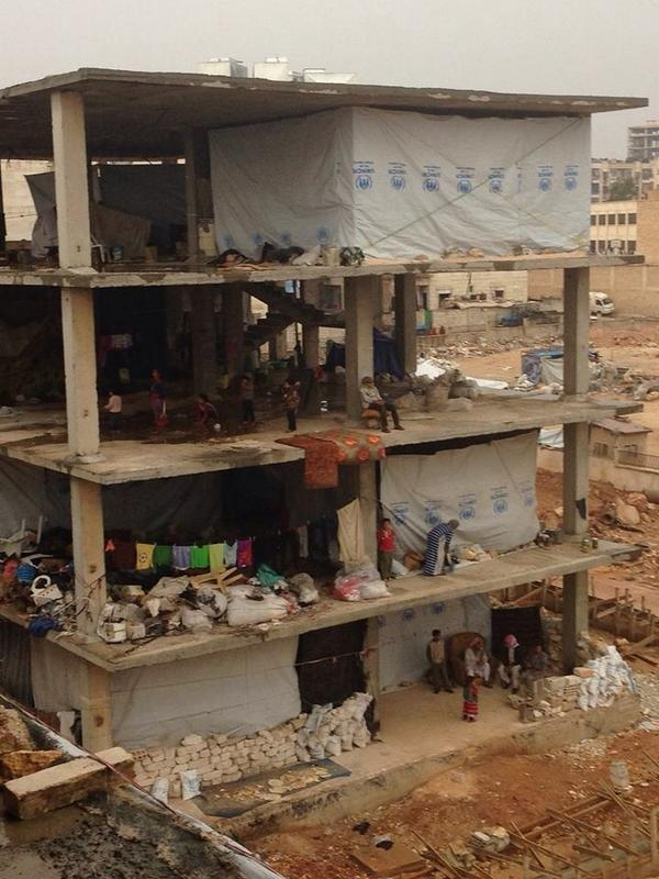 Displaced families in Aleppo have to stay in a half built apartment block