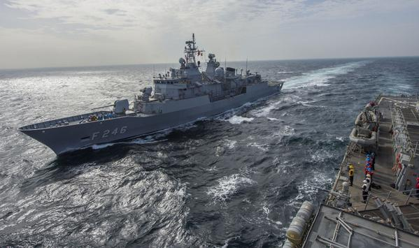 Turk frigate SALIHREIS (F 246) runs alongside destroyer USS COLE in the Black Sea yesterday