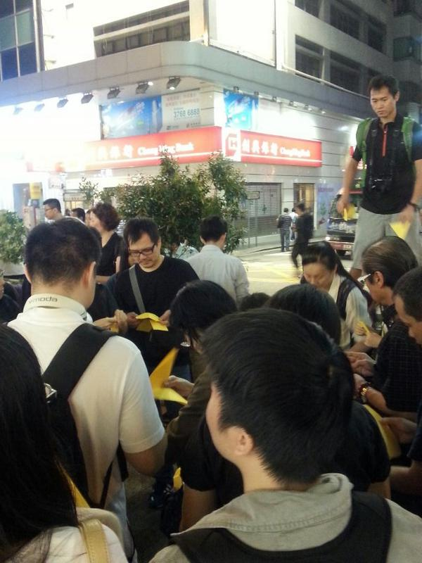 Arts class: People learning how to make paper yellow umbrella on Nathan Road. OccupyCentral OccupyHK