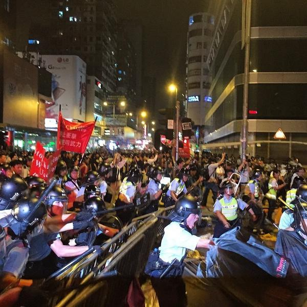 Police make a sudden and unprovoked charge at the protester lines on Nathan Road