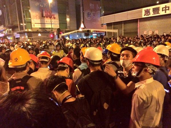 Many protesters now wear helmets