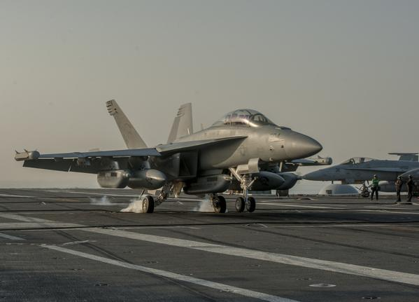 Arabian Gulf - EA-18G Growler makes arrested landing on flight deck of Nimitz-class aircraft carrier USS Carl Vinson