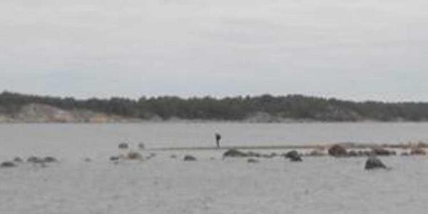 The man in the black in the area of the Stockholm archipelago