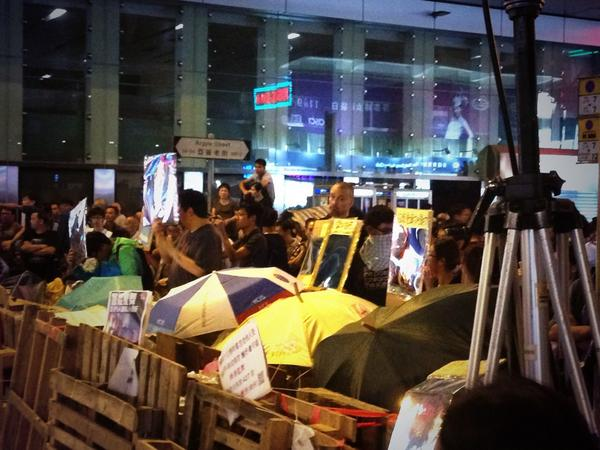 Mong kok - Holding mirrors and signs up to police - like the mean Lego cop OccupyHK