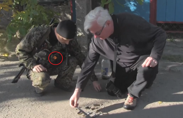@hrw expert and Russian terrorists inspecting cluster munition in Ukraine.