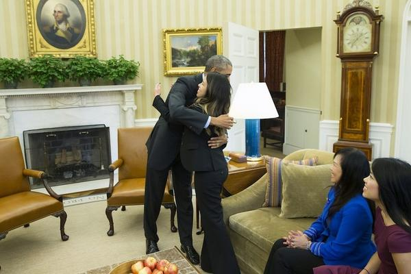 Nina Pham gets a hug from President Obama just hours after being declared  Ebola free
