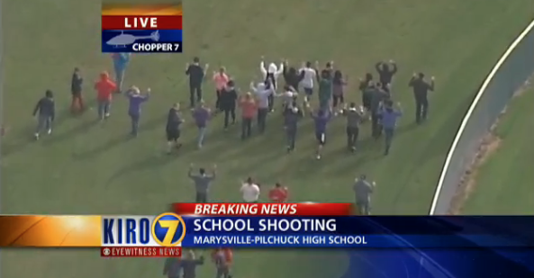 High school students now coming out with their hands up in what appears to be a school shooting in Washington State