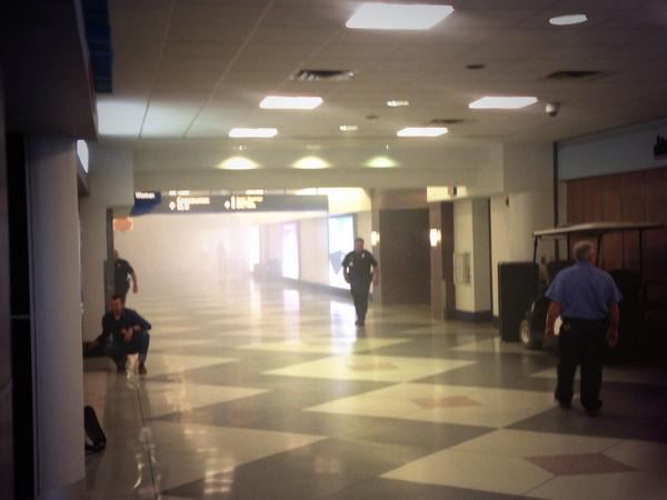 Charlotte airport in North Carolina is being evacuated due to fire. Corridor filled with smoke