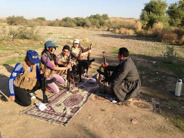Kurdish father in Kirkuk, Iraq teaches his children to safely shoot