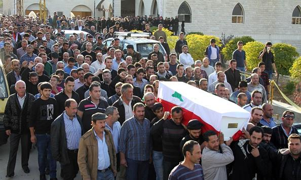 Family members carry the casket of Army soldier Abbas Ibrahim during his funeral in Bekaa. Lebanon