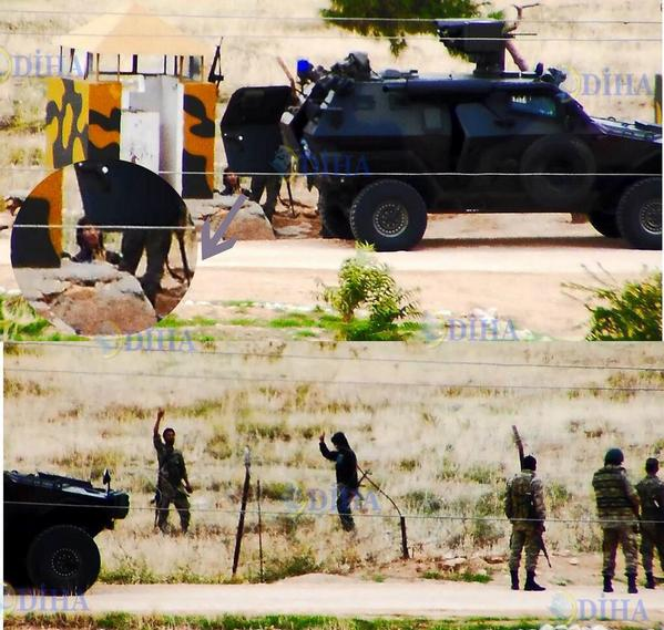 ISIS militants and Turkish army on Syria - Turkey boarder at Kobani .