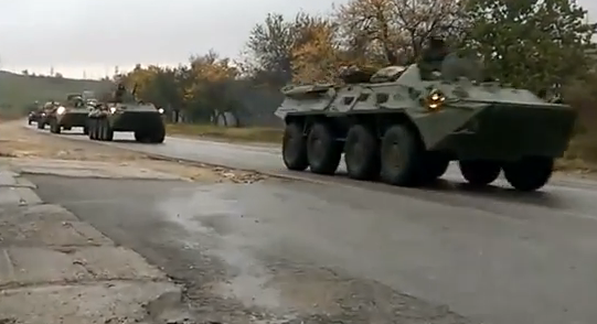 A large unmarked Russian army convoy moves north in Crimea