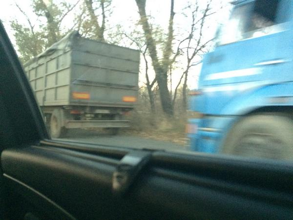 At Donetsk-Russia border today, slow flow of vehicles sans ID plates driven by camo-clad men, 20+ convoy of trucks