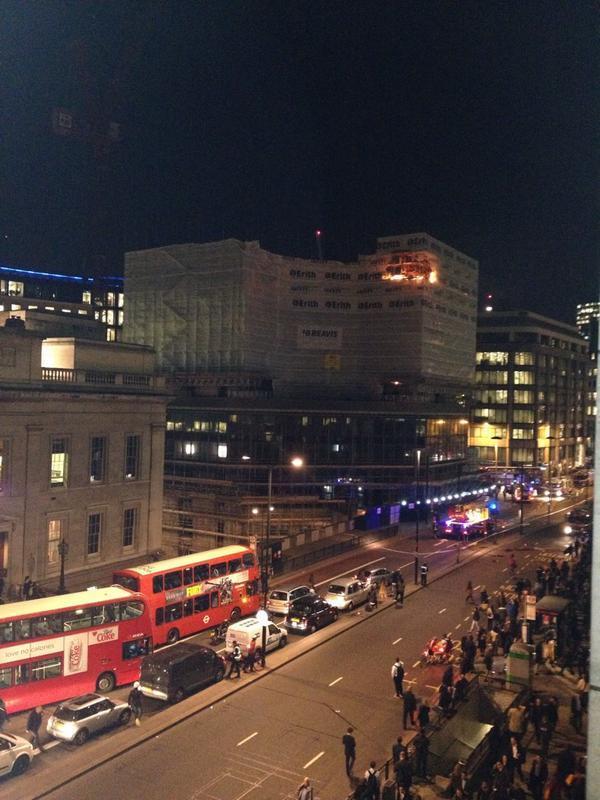 Big big fire at LondonBridge guys, debris falling on pavement, road closed