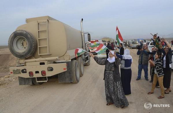 Iraqi Kurdish forces enter Kobani to confront Islamic State