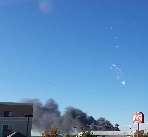 Emergency crews responding to a possible plane down near Mid-Continent Airport in Kansas