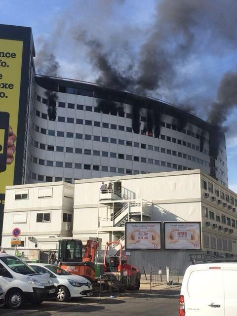 Radio France building on fire in Paris, explosions heard.