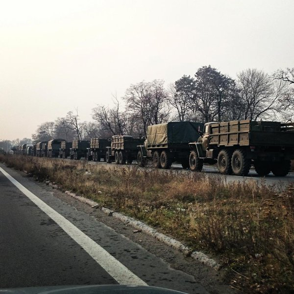 Huge military convoy is waiting on the eastern entrance to Donetsk.  Armed Kamaz trucks w munitions, Grads, a/a guns