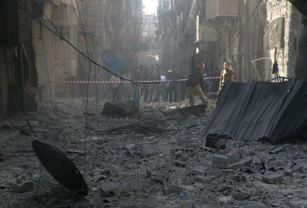 With world's attention focused on ISIS, Syria reportedly drops 401 barrel bombs in two weeks.