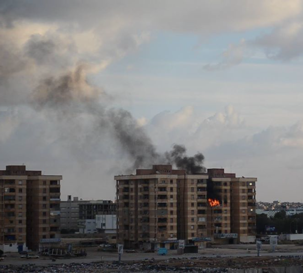 The Salmani Building was hit by an indiscriminate shell reportedly fired by Ansar Sharia forces. Benghazi Libya