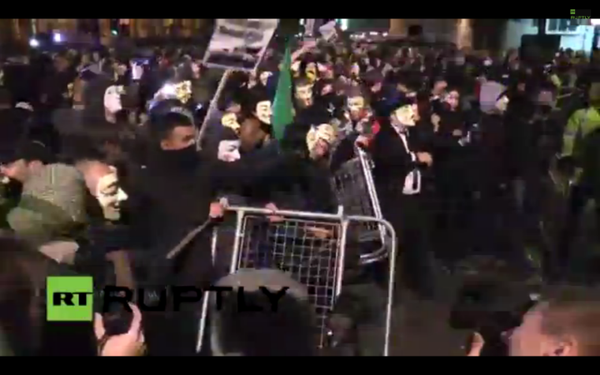 London Riot Cops and MillionMaskMarch protesters battle over barricades