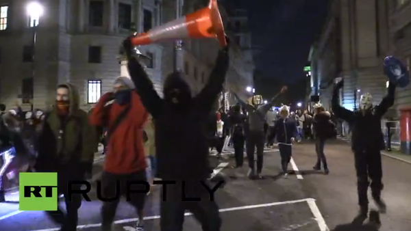 Protesters shout Who's streets? OUR STREETS as they walk down the street in London, heading to Buckingham Palace