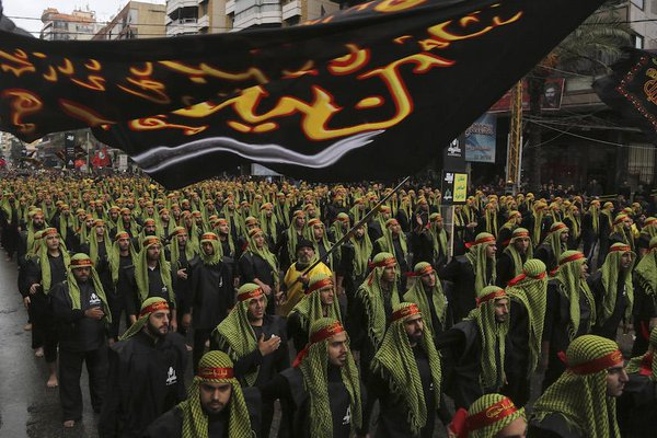 Lebanese Hezbollah supporters march during a religious procession to mark Ashura in Beirut