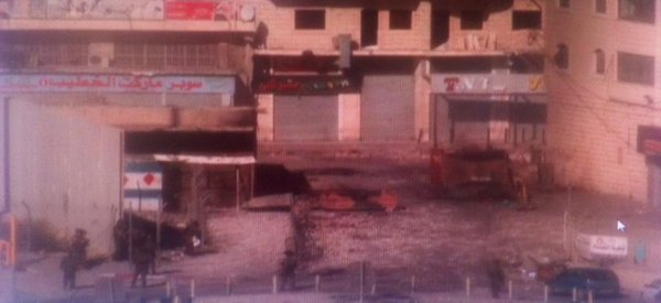 East Jerusalem now: Palestinian youths throwing rocks & burning tyres
