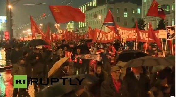 Moscow, Russia October revolution anniversary. Novorossiya flag is there as well
