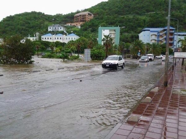 Rain and floods continuing in StMaarten , one of four countries in Kingdom of the Netherlands