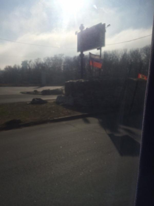 A Russian flag at a checkpoint in Donetsk