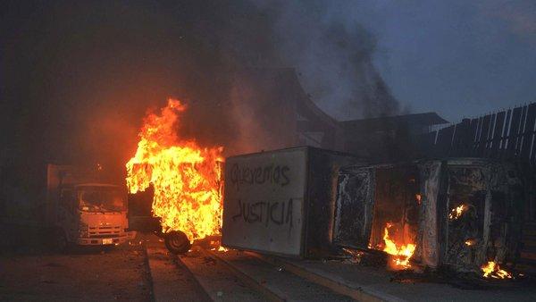 Mexico protests turn violent over apparent student massacre.