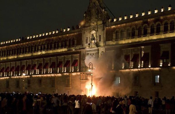 The Door Of The Presidents Palace In mexico Set In Flames By Protesters.